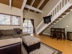 Open concept Studio + Loft, Kitchen, Dining table, living room and stairway to loft