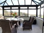 The conservatory provides a wonderful dining space