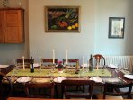 The long mahogany table is perfect for relaxed family dinners