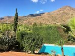 The natural Parque Pedregales and the 4500 feet Los Reales mountain are nice backdrops to the garden