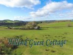 Hillend Guest Cottage from hills behind