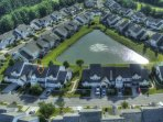 Areal view of our beautiful community around the peaceful lake. Front  of house shown.