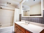 Middle shared bathroom with tub and shower