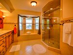 Huge walk in shower and exquisite custom cabinetry.