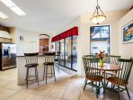 The centrally located kitchen is the place to be with views of the pool area