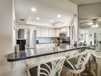 The new blue granite kitchen and stainless steel appliances