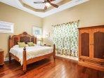The exquisite hardwood master king bedroom
