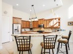 The fully stocked granite kitchen, with stainless steel appliances and gas cooking stove