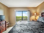 Plush and comfortable king bedroom with sweeping views and balcony access
