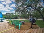 Enjoy outdoor grilling or s'mores by the fire pit on the large front lawn with lake breezes.
