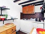 Kitchen with washing machine,oven,fridge
