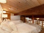 You will get a great night sleep in the sleeping loft, featuring a full and twin platform bed with new, comfortable...