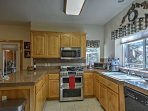 Fully equipped, the kitchen features stainless steel appliances and a double oven.