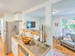 The fully equipped kitchen features a stunning modern design and ample cooking space.