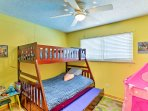 Kids will love sharing this bedroom, as it has a twin-over-full bunk bed and twin trundle bed.