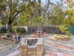 Throw some burgers on the wood-burning fire pit and then gather around the picnic table for the perfect outdoor...