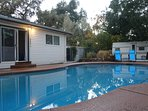 The backyard features an enormous swimming pool with a diving board to enjoy year-round.