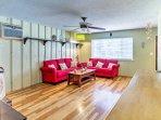 Hardwood flooring meets your feet in the living room.