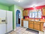 Modern appliances, a double sink, and ample counterspace make preparing home-cooked meals effortless!