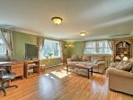 Enter the bright and inviting living room highlighted by beautiful hardwood floors.