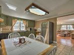 Whip up a home-cooked meal in the fully equipped kitchen with stainless steel appliances.