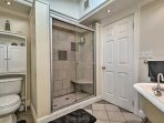 The first bathroom offers a walk-in shower and a separate tub.