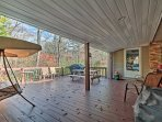 Enjoy a barbecue and sunshine on the deck which features ample outdoor chairs, a gas grill, and a couch swing.