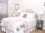 Queen sized bed in quest bedroom