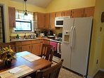 Kitchen w/ full stove, fridge, washer /dryer, microwave, coffee pot, toaster & microwave