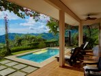 Veranda, garden mountain and pool view.
