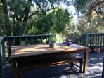 Back deck BBQ and entertainment area overlooking huge gardens with soaring native Australian trees
