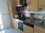 Fully equipped kitchen with oven and hob, fridge-freezer, dishwasher, microwave