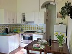 Fully equipped kitchen with dishwasher, oven, toaster, fridge and coffee maker.