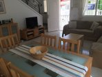 Living room with dining table for 6, satellite TV, wifi