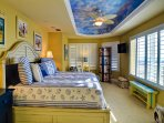 Large master bedroom with a beach view