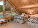 Loft bedroom with 2 full size beds, fall asleep with the river murmur.