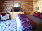King bedroom, main level, opens to the deck with jacuzzi, facing the Gallatin River.