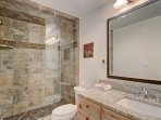 Ensuite Master Bathroom - The ensuite bathroom features a walk-in shower with beautiful tiling.