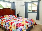 Bedroom 1 with queen bed.Nice and bright with natural Hawaiian sunlight coming through.