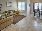 The open front room welcomes you with tile floors and beautiful natural lighting.