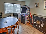 There's plenty of entertainment options in the game room, featuring a dart board, video games, and a table to play...