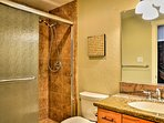 Enjoy a refreshing rinse in this full bathrooms walk-in shower.