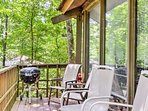 Enjoy the lush forest views from the deck after a day walking around one of 3 lakes in the community.