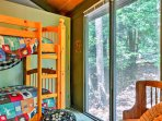 This bedroom offers a twin-over-twin bunk bed and a twin bed.