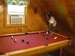 Sprial stairs lead to the loft area with pool table