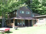 Roaring Brook Cottage with picnic table and fire pit