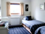 Equally spacious twin bedroom