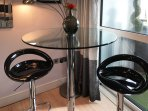 Bar stools and table to enjoy a glass of fizz
