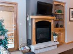 Gather around the gas fireplace and large flat screen TV
