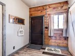 The front entry way of the home, a place to kick off your shoes, and start your vacation!